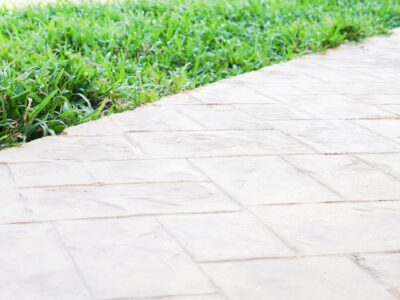 This is an image of a concrete walkway with brick stamp design.