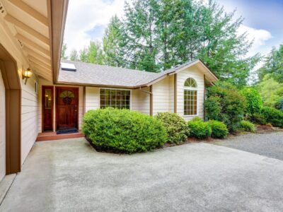 This is an image of a residential property with a concrete driveway.